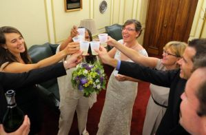 Newlyweds and their friends toast to their recently completed wedding ceremonies at St. Louis City Hall on Wednesday, June 25, 2014. Four same-sex couples were married in separate ceremonies on Wednesday. Photo By David Carson, dcarson@post-dispatch.com