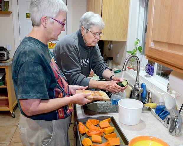 Anita Blanchard, left, and Diane McMullin prepare dinner in their Durango home. They say they have been married in their hearts for 21 years. They were finally able to sign legal paperwork Oct. 9 to make it official.