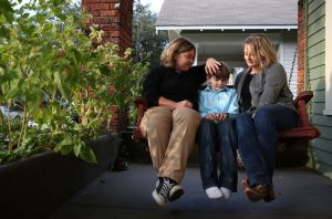 Cari Searcy, left, and Kim McKeand, who legally married six years ago in California, are pictured with their son Khaya Searcy, 8, on Tuesday November 11, 2014 in Mobile, Ala. State officials, citing Alabama's constitutional ban on same-sex marriage, denied Searcy's second-parent adoption of the child. (Sharon Steinmann/ssteinmann@al.com)