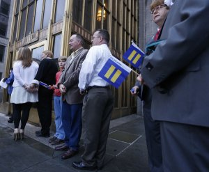 Same-sex couples waited for the Jefferson County courthouse doors to open on Monday in Birmingham. Credit Hal Yeager/Associated Press