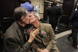 Robert Povilat, left, and Milton Persinger celebrated the U.S. Supreme Court's decision not to stop same-sex marriages in Alabama. The couple were in line to be the first same-sex couple married in Mobile, Ala. Credit Dan Anderson/European Pressphoto Agency