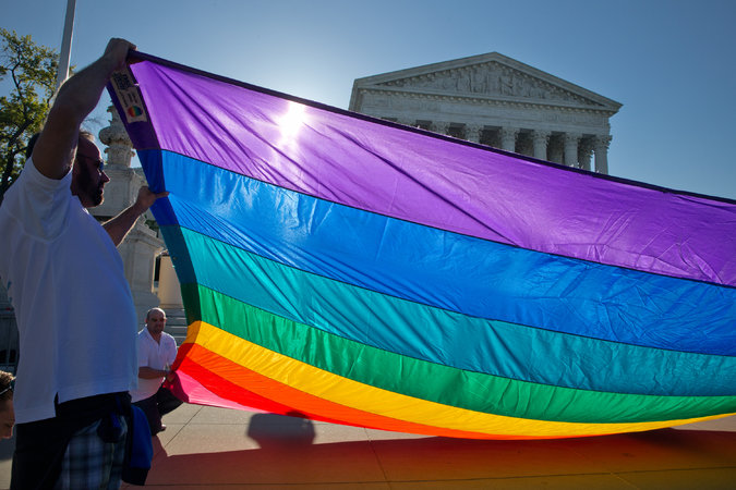 Supporters of same-sex marriage gathered in front of the Supreme Court on Tuesday as the justices prepared to hear arguments on the issue. Credit Stephen Crowley/The New York Times