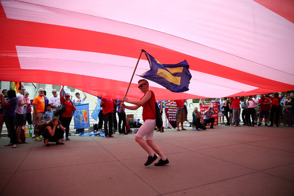 Supporters of same-sex marriage gathered outside the Supreme Court on Friday. Credit Doug Mills/The New York Times